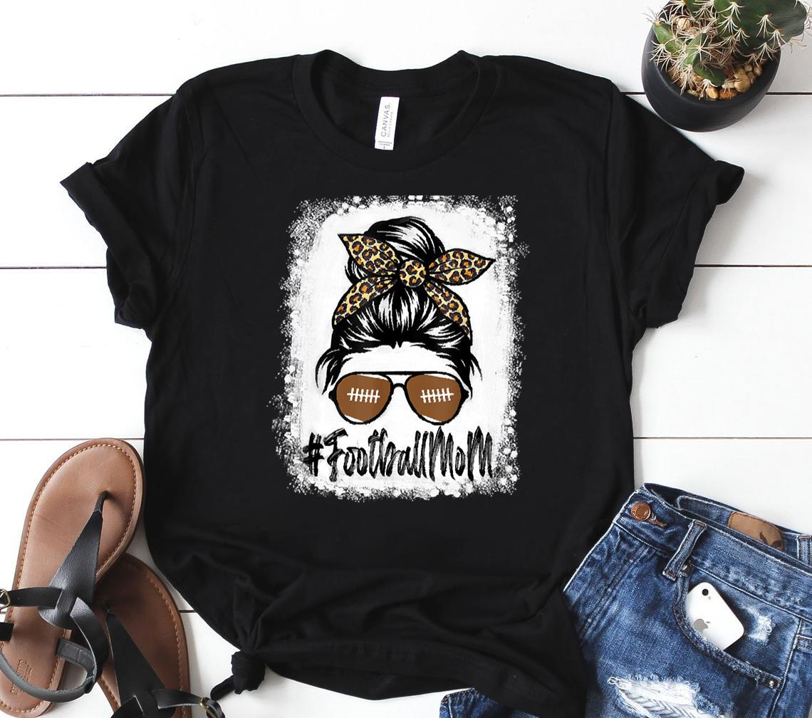 football mom life messy bun bleached leopard football player mom perfect gift for football lovers wo classic shirt